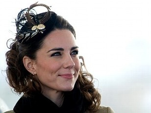 Kate Middleton wearing a Vivien Sheriff fascinator. AP Photo.