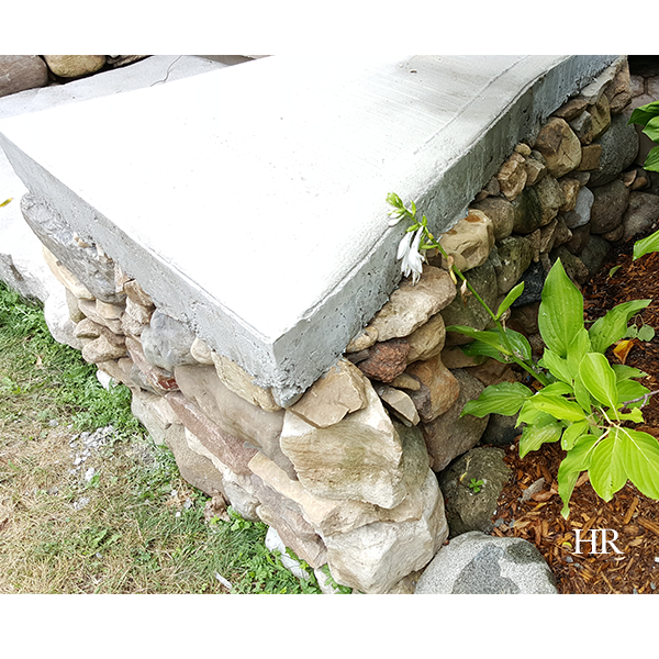 dry lay stone bench with cement cap