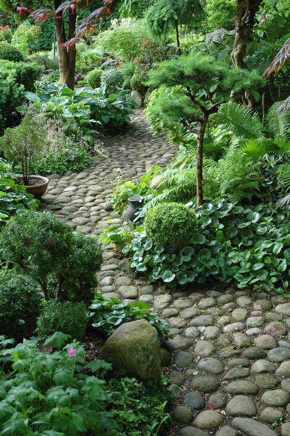 shade gardens with stone pathway